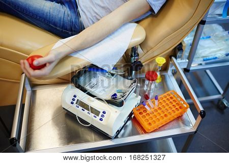Human arm with flexor and blood-transfusion equipment near by
