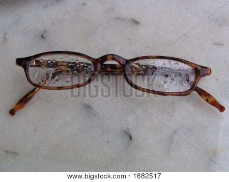 Raindrops On The Glasses Of Readingspectacles