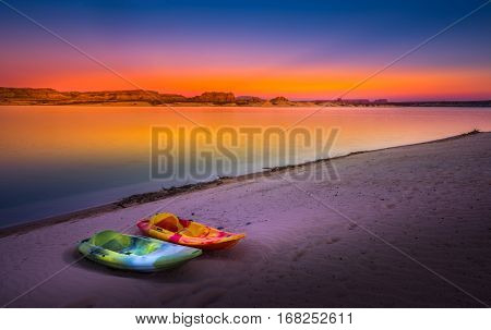 Kayaking Lake Powell Lone Rock At Sunset Utah Usa