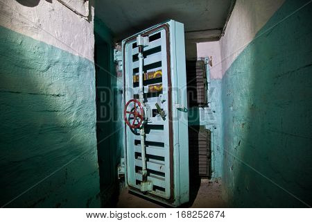 Hermetic door of an abandoned Soviet bomb shelter, an echo of the Cold War, Voronezh, Russia
