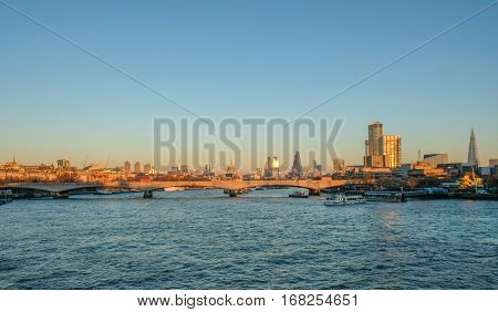 Skyline photo of London showing Waterloo bridge and the City beyond.