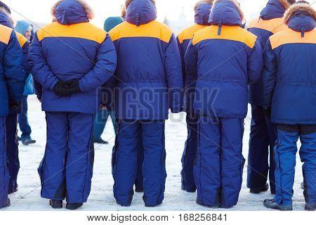 Emergency patrol in blue uniform standing in row