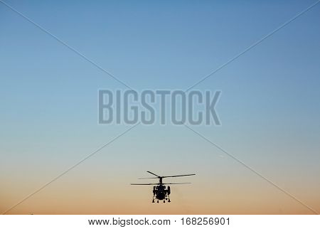 Search and rescue helicopter on background of evening sky