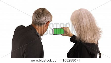 Elderly Couple Using Smartphone To Take Pictures On White Background