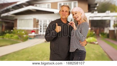 Happy New Senior Homeowners Smiling At Camera