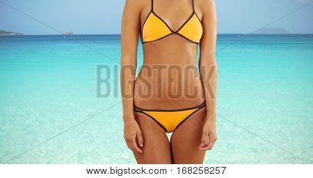 Midsection Of A Young White Girl Standing On A Caribbean Beach