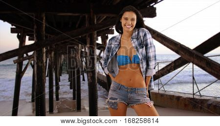 Millennial White Woman Stands Under The Pier Posing For A Portrait
