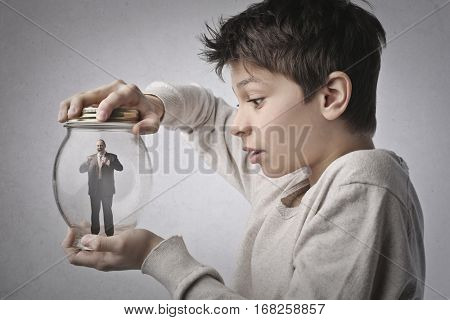 Child managed to capture a tiny businessman in a jar