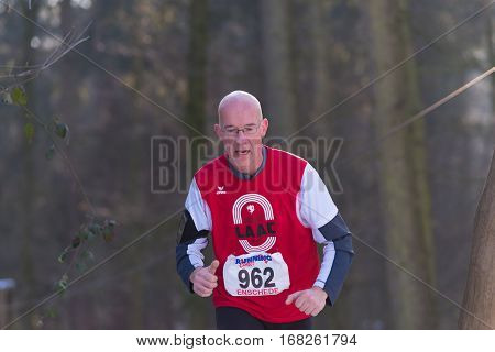 OLDENZAAL NETHERLANDS - JANUARY 22 2017: Unknown runner doing a cross run in a forest