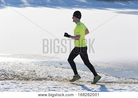 OLDENZAAL NETHERLANDS - JANUARY 22 2017: Unknown runner doing a cross run in a snow white landscape