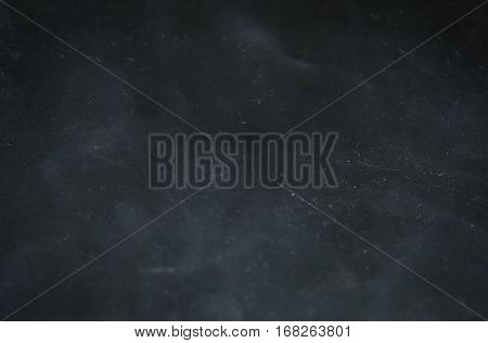 Abstract dark background. The texture of dirty scratched plastic. Rectangular.