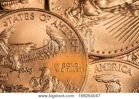 Composite modification of golden coin to say in GOLD we trust instead of in God we trust in USA