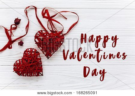 Happy Valentines Day Text Sign. Stylish Red Hearts Flat Lay On White Wooden Background. Happy Valent