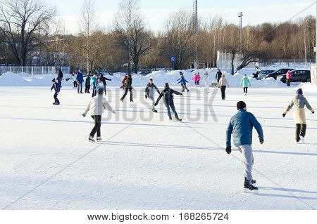 PETROZAVODSK, RUSSIA - JANUARY 28TH, 2017: Unidentified people skating on the outdoors ice rink