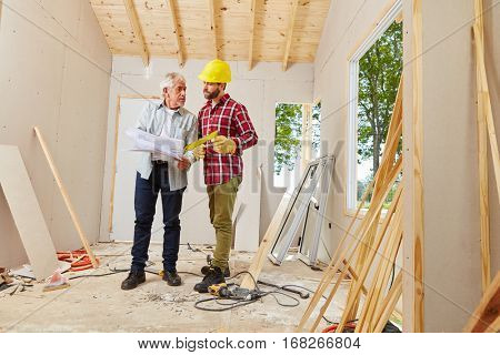 Architect and foreman working during meeting for building construction