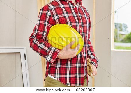 Man as black worker with helmet working on building construction