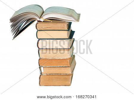 Open book stack of hardback books isolated on white background. Back to school. Copy space