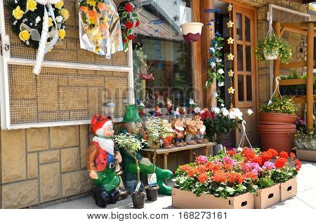 Bytca Slovakia - May 17 2011: Display of flower shop containing flowers and garden gnomes
