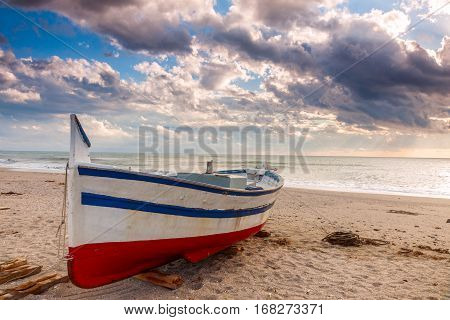 Boat On The Beach At Sunset Time