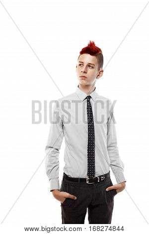 Portrait of serious teen with red mohawk wearing shirt and tie while looking away.Isolated.