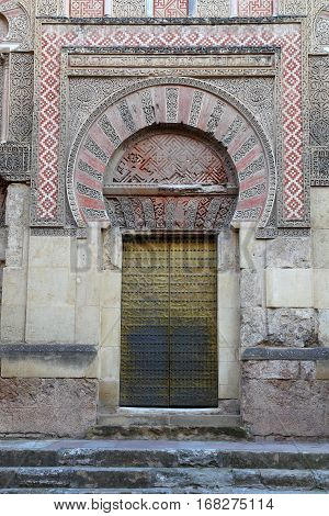 Door of the mosque of Cordova. Court of the orange trees, Mosque of Cordova  is part of the Cathedral Mosque of Cordoba, and is undoubtedly the largest and oldest courtyard of the city of the year 786.