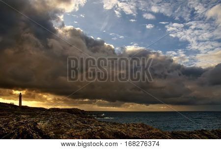 Lighthouse in stormy sunset Isle of Lewis Scotland