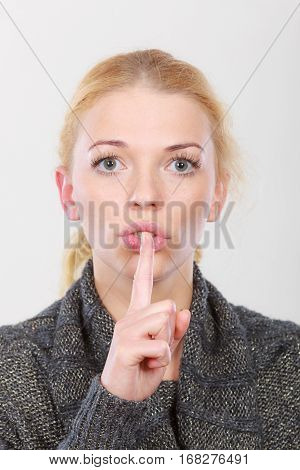 Woman Holding Finger Close To Lips, Silence