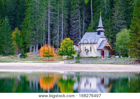 Little Chapel At The Braies Lake In Dolomites Mountains