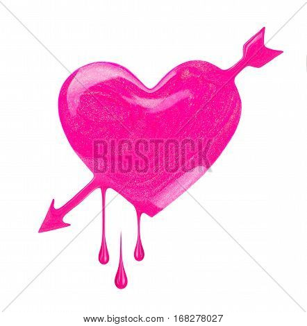 Plash of pink nail polish in the form of heart with arrow. Concept image dedicated to St. Valentine's Day