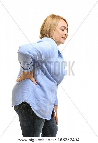 Senior woman suffering from backache, on white background