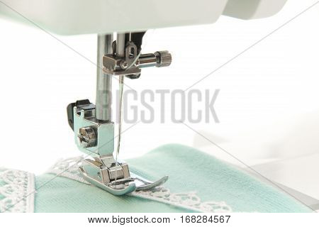 The Sewing On The Sewing Machine Turquoise Fabric
