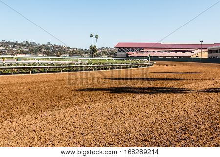 DEL MAR, CALIFORNIA - NOVEMBER 25, 2016:  Dirt race track and horse barns of the second largest horse racing venue in the western United States.