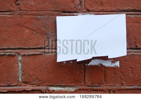 Announcement on a brick wall