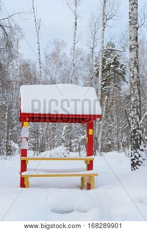 Arbor in a winter forest