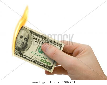 flammendes Geld in der hand