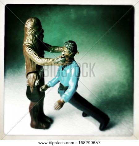 Vintage Kenner Star Wars Chewbacca action figure chocking Lando Calrissian - recreating a scene from The  Empire Strikes Back. Filtered image.