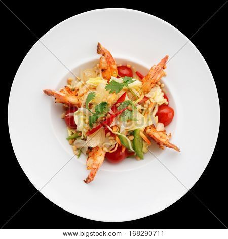 Prawn appetizer with cabbage, bell peppers and tomatoes isolated on black background