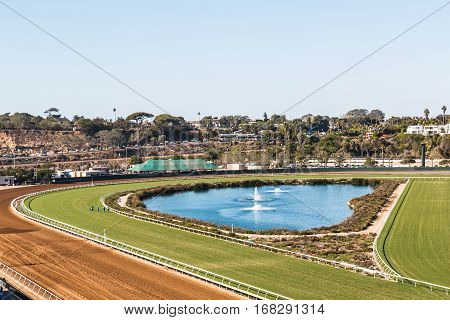 DEL MAR, CALIFORNIA - NOVEMBER 25, 2016:  Fountain with both dirt and grass race tracks at this thoroughbred horse racing venue.
