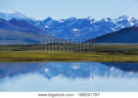 Serenity lake in tundra in Alaska