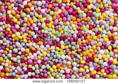 Colorful candy sprinkles.  Full frame background, large file.  Known as hundreds and thousands.