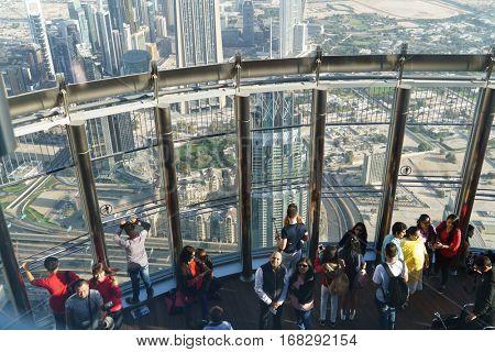 Dubai, UAE - January 06, 2017: Tourists meet sunrise at the observation deck on the 125 floor of Khalifa tower