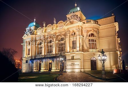 Juliusz Slowacki theater in Krakow. Poland. Famous architecture landmark of old european town foggy nighttime illumination.