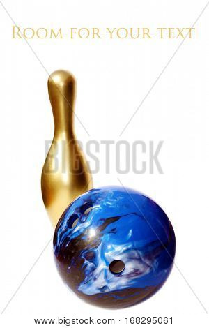 Blue bowling ball and golden bowling pin. isolated on white with room for your text.