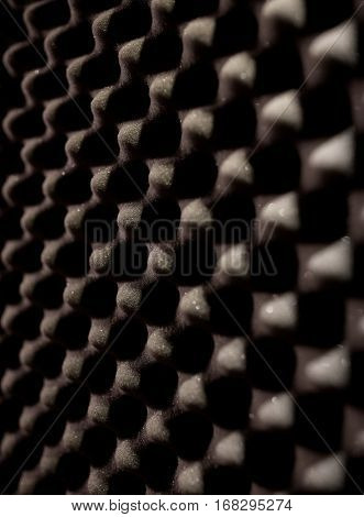 acoustic materials, texture and soundproofing concept - foam rubber surface at sound recording studio