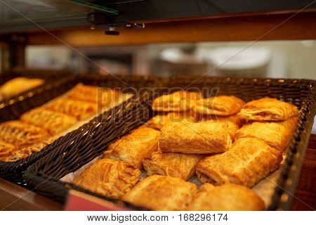 food, baking and sale concept - close up of pies at bakery or grocery store