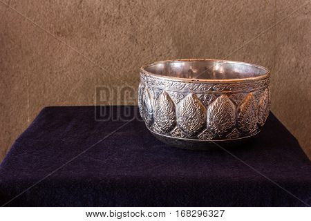 Still life of Cold water in silver water bowl of Thai style
