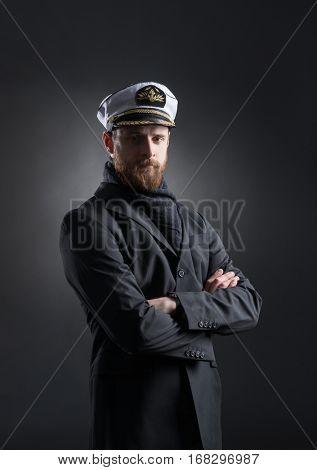 Portrait of a handsome sailor over black background.  Shipping, navigation, marine, navy concept.