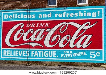 Lafayette - Circa February 2017: Reproduction of a Classic Coca Cola Advertisement. Coke was introduced in 1886 I