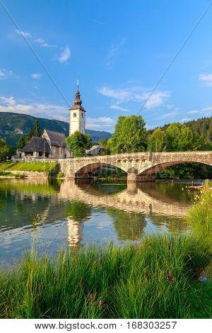 Church Of Sv. John The Baptist And A Bridge By The Bohinj Lake