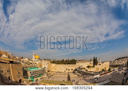 The area of the Western Wall of the Temple after the prayer. Autumn holiday of Sukkot. Windy autumn day